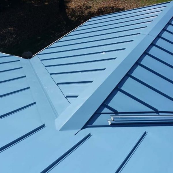 Blue Standing Seam Metal Roof by Specialty Construction